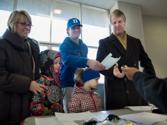 Zach Phillips receives tickets to the tournament Thursday, Dec. 28, 2017, with 6-year-old Lydia Phillips, 5-year-old Selah Phillips, Gaye and Marty Phillips, of Pinson, during the 2017 Hub Classic at Oman Arena in Jackson.