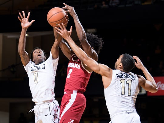 Vanderbilt guard Saben Lee (0) and forward Jeff Roberson (11) battles Alabama guard Collin Sexton (2) during the first half at Memorial Gym in Nashville, Tenn., Tuesday, Jan. 2, 2018.