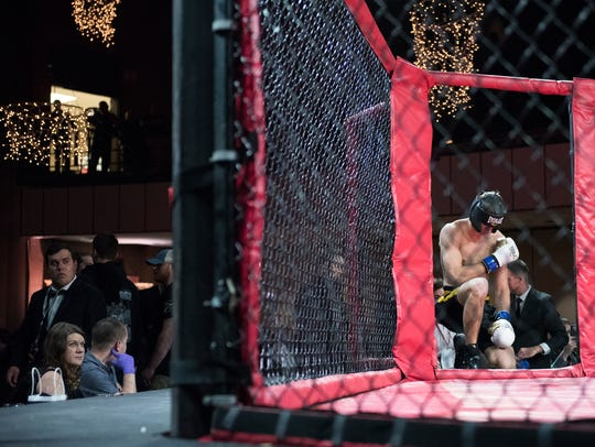 MMA fighter Charlie Allen, kneels in prayer before