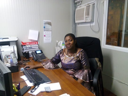 Uwolowulakana Ikavi-Gbetanou, a spokeswoman for U.N. peacekeeping forces in Bangui, Central African Republic, poses for a photo in her office.
