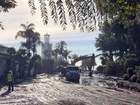 This photo provided by the Santa Barbara County Fire Department shows the cleanup of mud and debris in front of the Coral Casino and Biltmore Hotel along Channel Drive in Montecito on Wednesday.