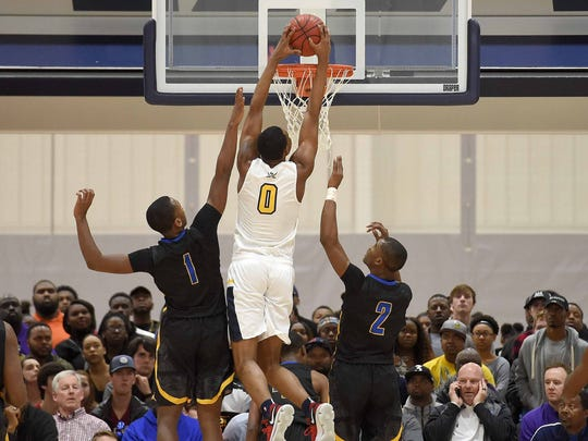 Olive Branch's D.J. Jeffries (0) dunks against Canton