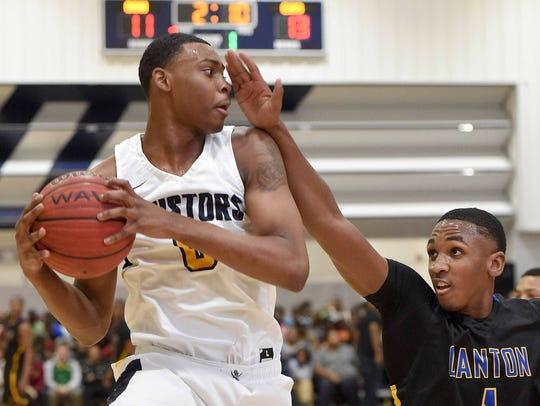 Olive Branch's D.J. Jeffries (0) looks for teammate