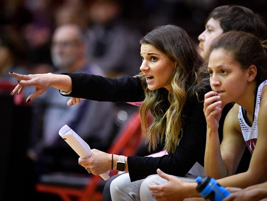 Ravenwood head coach Mariska Harris watches her team