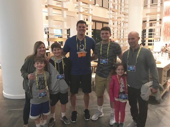 Ryan Kerrigan, the former Central star, stands with