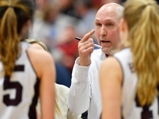 Franklin girls basketball coach John Wild has led the Lady Rebels to a 27-2 record entering the Region 6-AAA quarterfinals.