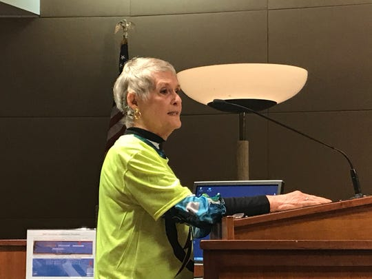 Sandra Spencer Miller speaks out against a proposal to buy a house in her subdivision for a future electrical substation expansion.