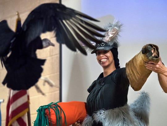 Dressed as a rabbit, Sandra Fly, of Nashville, holds