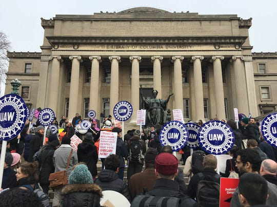 Demonstrators advocate for a union at Columbia University in New York on Feb. 1, 2018 after the school announced earlier in the week that it won't bargain with the students who voted overwhelmingly for union representation more than a year ago.  The UAW is the union.