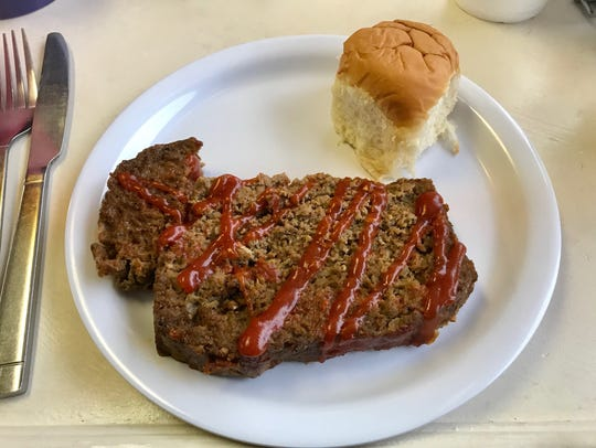 The meatloaf at TGS Cupcakery and Bistro is plated