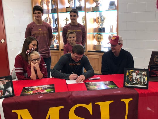 Holliday's Justin Jones signs a letter of intent to play football at Midwestern State.