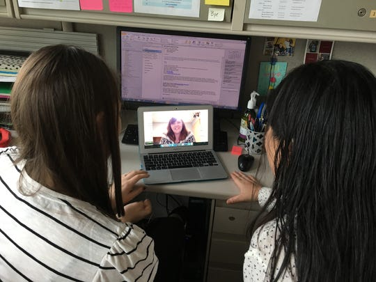 Speech language clinician Amy Banasik (left) and Vivian Nguyen (right) talk to Kristen Lundstrom over Skype about how her son, Tyson, is responding to different speech and language strategies.