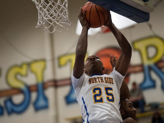 North Side's Travien Collier attempts a basket Friday,