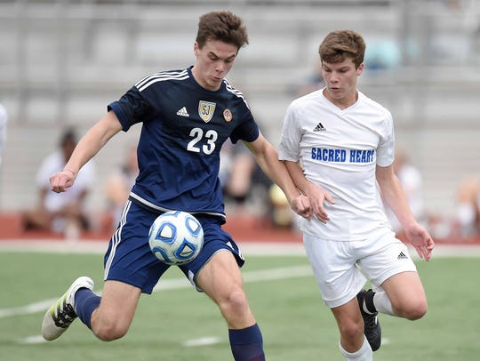 St. Joseph's Reed Collins (23) moves the ball past