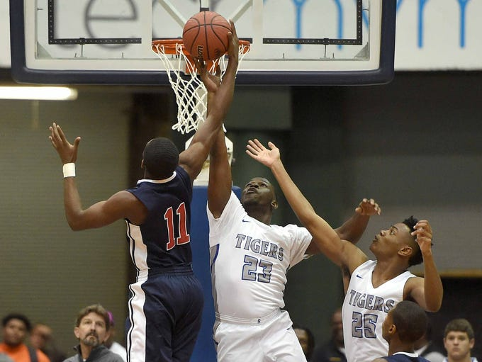 Forest Hill's Marc Evans (11) competes for a rebound