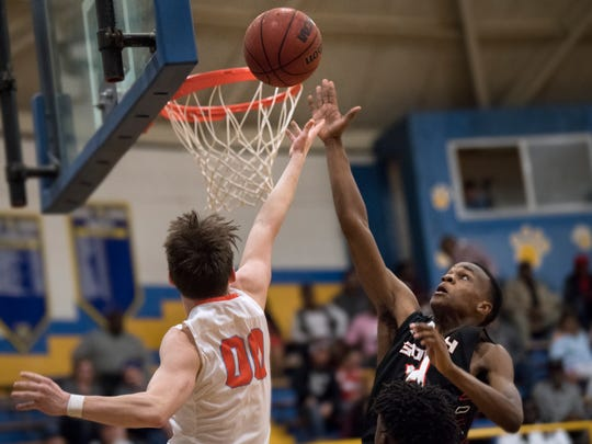 South Side's Janias Parram attempts a layup while defended by South Gibson's Marshall Boyd on Thursday, March 1, 2018, during South Side's 60-56 Region 7-AA title win over South Gibson at McNairy Central High School in Selmer.