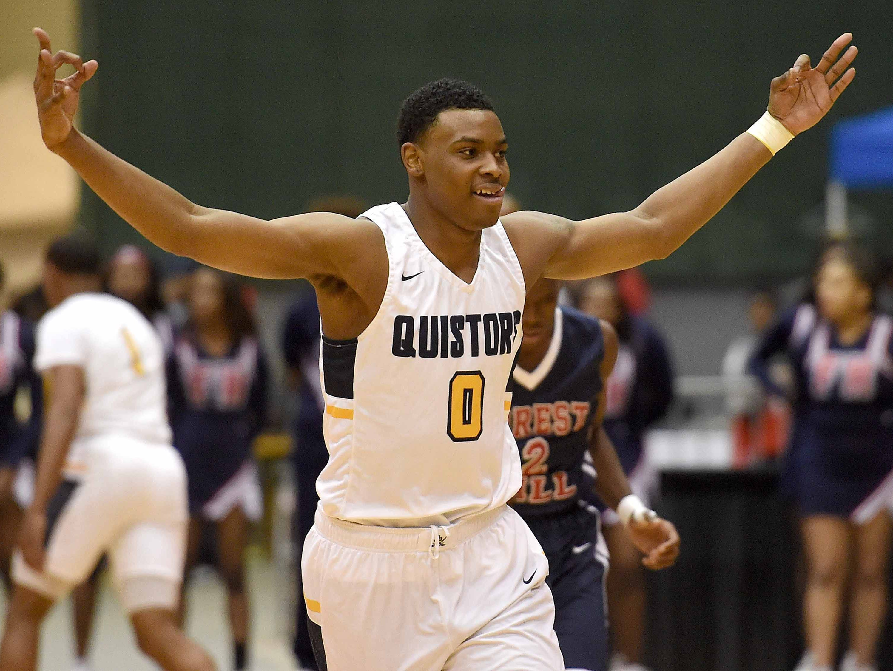 Olive Branch's D.J. Jefferies (0) celebrates his three pointer against Forest Hill in the finals of the MHSAA C Spire State Basketball Tournament at the Mississippi Coliseum in Jackson, Miss., on Friday, March 9, 2018.