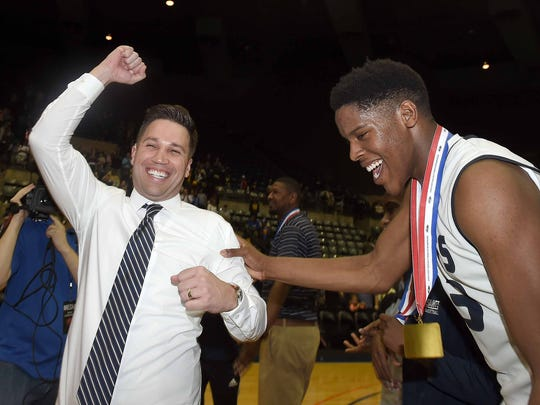 St. Andrew's head coach Brian Cronin (left) and Garrison Wade celebrate in the finals of the MHSAA C Spire State Basketball Tournament at the Mississippi Coliseum in Jackson, Miss., on Saturday, March 10, 2018.