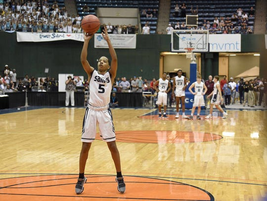 St. Andrew's Rashad Bolden (5) shoots free throws after