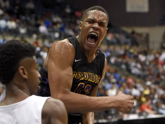 Columbus Falcon Robert Woodard (12) celebrates his dunk against Meridian in the finals of the MHSAA C Spire State Basketball Tournament at the Mississippi Coliseum in Jackson, Miss., on Saturday, March 10, 2018.