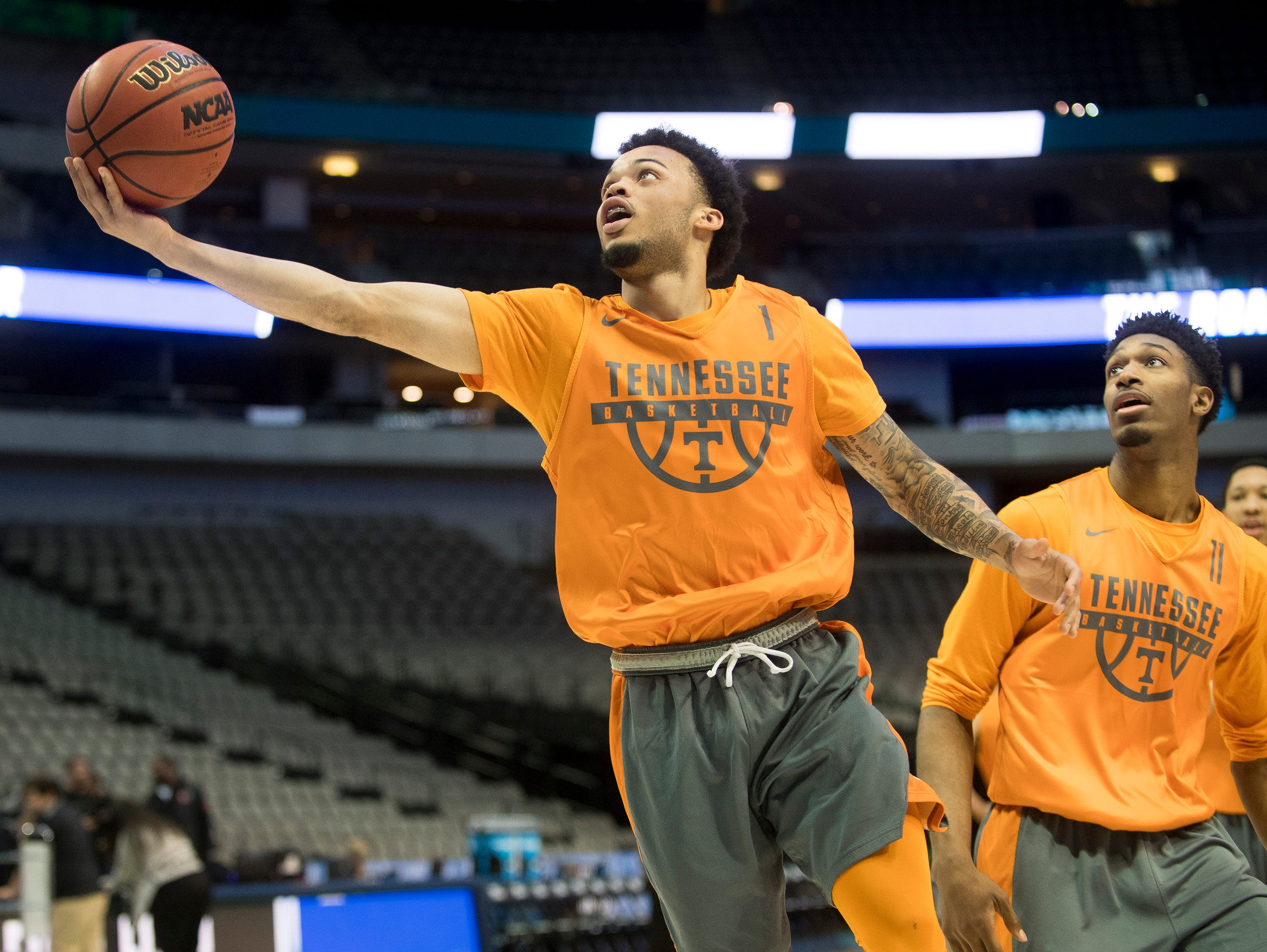 Tennessee guard Lamonte Turner (1) attempts a shot during practice at American Airlines Arena on Wednesday, March 14, 2018, ahead of the NCAA Tournament first round game between Tennessee and Wright State.