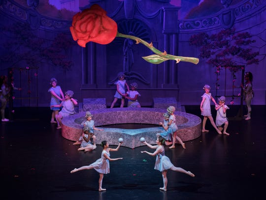 "Dancers perform a scene of ""Beauty and the Beast"" Friday,"