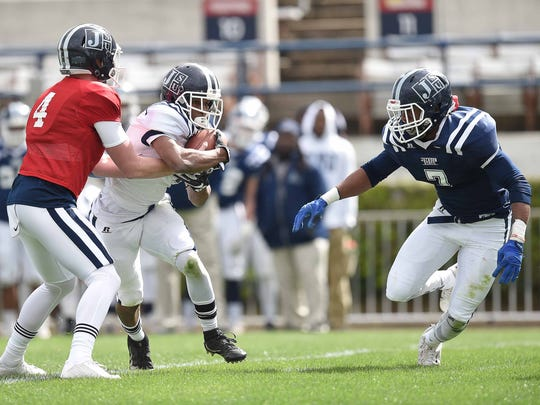 Jackson State Eric Bowie (7) zeroes in on white team running back Terrell Kennedy (4) behind the line on Sunday, April 15, 2018, in the JSU spring game in Mississippi Veterans Memorial Stadium in Jackson, Miss.
