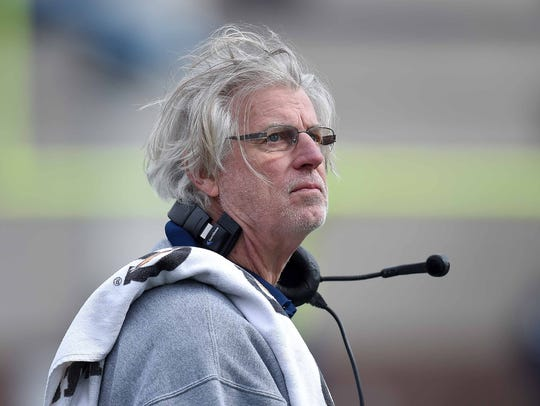 Jackson State white team coach Hal Mumme checks the
