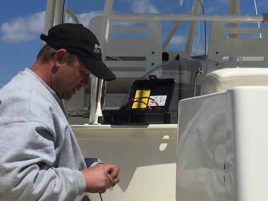 Corey Wisniewski, a mechanic at Comstock Marina in