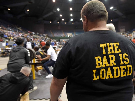 A Pontotoc coach watches one of his lifters on Saturday, April 21, 2018, in the MHSAA State Powerlifting Championships in the Mississippi Coliseum in Jackson, Miss.