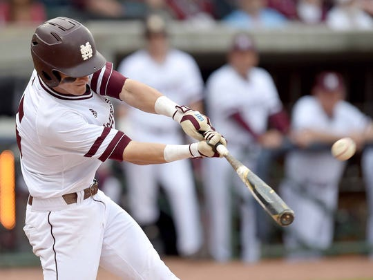 Mississippi State's Jake Mangum hits against Ole Miss