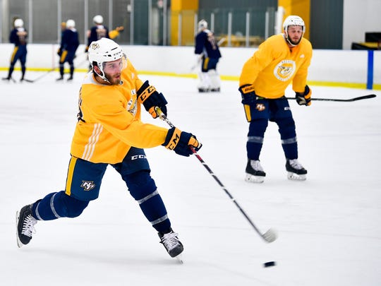 Ryan Hartman takes a shot during a Predators practice at Centennial Sportsplex in April.