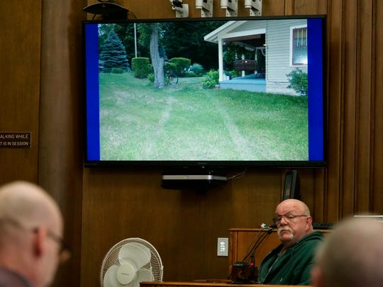 William Myers testifies during Charles Pickett Jr.'s murder trial, Thursday, April 26, 2018, in Kalamazoo, Mich. Pickett is accused of driving under the influence of drugs and faces second-degree murder charges for plowing into a group of bicyclists in Cooper Township in June 2016. Myers pointed out tire tracks showing the route Pickett's truck took through a vacant lot and through his yard.