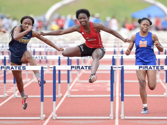Brandon's Jerricka Ambus (center) clears the final