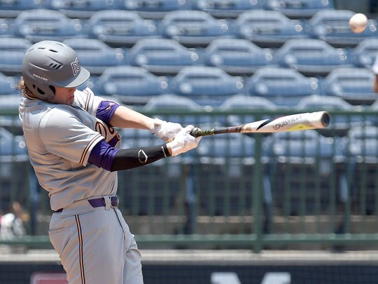 DeSoto Central's Blaze Jordan hits against George County