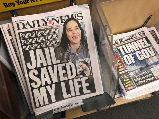 Copies of the New York Daily News are for sale at a newsstand in New York, Monday, July 23, 2018, after the paper told employees that the newspaper is reducing its editorial staff by 50 percent.
