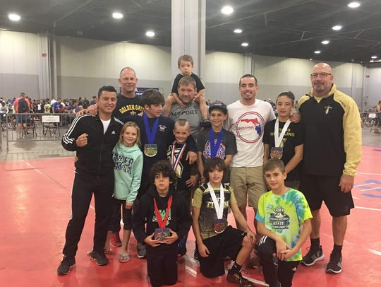 Members of the Naples Titans Wrestling Club, from top