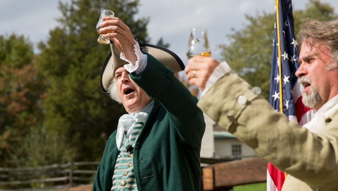 Dean Malissa of Philadelphia, a historical portrayer of George Washington, left, toast the first single malt whisky produced at George Washington's Distillery, Tuesday, Oct. 13, 2015, in Mount Vernon, Va. After a three-year aging process, distillers at George Washington's Mount Vernon estate tasted a batch of single malt whisky made at the estate's distillery. Scottish distillers teamed with Mount Vernon's own distiller in 2012 to make the whisky using 18th century methods employed by Washington and Mount Vernon's reconstructed, water-powered gristmill.