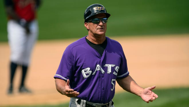 Louisville Bats manager Jim Riggleman has been promoted to the Reds' staff.