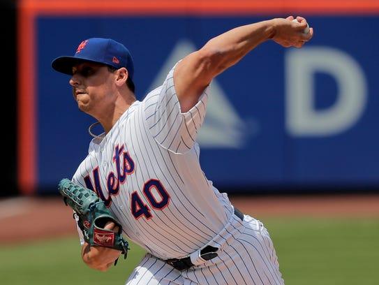 New York Mets starting pitcher Jason Vargas delivers
