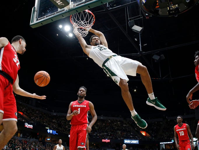 Michigan State's Kenny Goins dunks against Georgia's