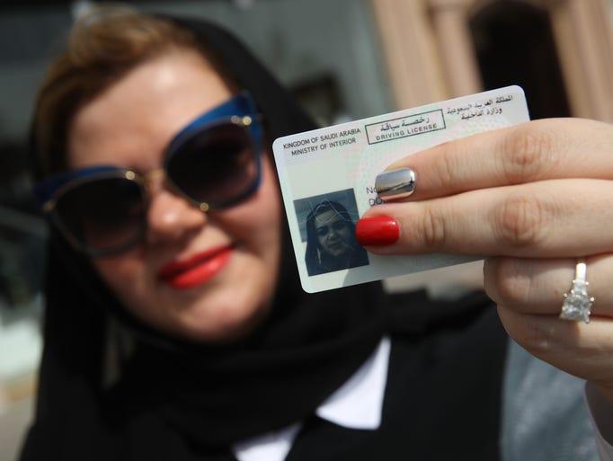 Nada Edlibi holds up her Saudi Arabian driver's license