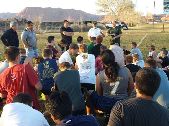 Snow Canyon coaches Jay Day and Michael Puriri talk to players after practice as the team gets ready to host one of the top rugby tournaments of the year this weekend. Admission is free to the public.
