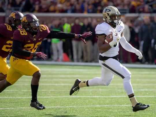 Purdue RB Raheem Mostert (8) rushes for a touchdown in the first half as Minnesota DB Jalen Myrick (28) attempts to make a tackle in the first half at TCF Bank Stadium.
