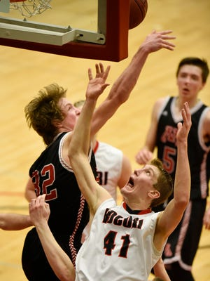 Rocori's Derek Thompson struggles for a rebound against Trevor Bautch of Monticello during the second half of Thursday's game at Halenbeck Hall in St. Cloud.