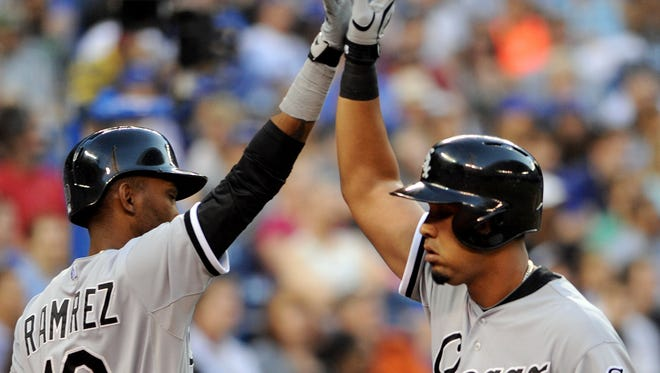 Chicago White Sox first baseman Jose Abreu is greeted at the dugout by shortstop Alexei Ramirez after hitting a home run in the fifth inning against Toronto Blue Jays at Rogers Centre.