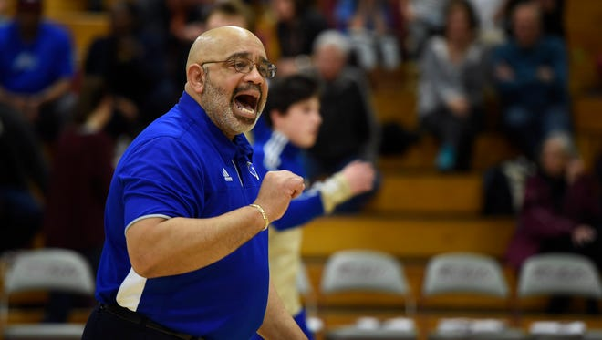 Brentwood assistant basketball coach Vince Carter Sr. yells at  his players before their game at Franklin High School Tuesday Feb. 7, 2017, in Franklin , Tenn.
