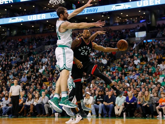 Toronto Raptors' Norman Powell (24) looks to pass around Boston Celtics' Tyler Zeller during the second half of an NBA basketball game in Boston Friday, Dec. 9, 2016. (AP Photo/Winslow Townson)