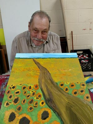"""Sonny, 86, an """"Imagine Art"""" artist, smiles after painting sunflowers at the Riverview Industries' studio in Salem Township."""