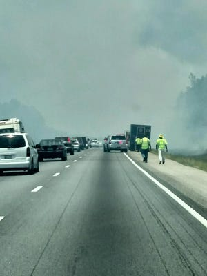 A grass fire on the side of Interstate 65 has stalled traffic in Autauga County.